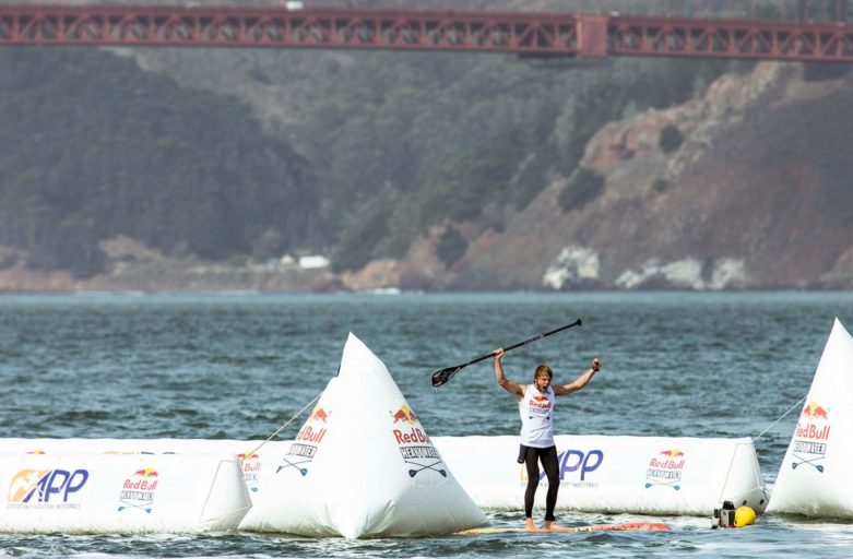 Casper Steinfath celebrates after winning the Red Bull Heavy Water Stand Up Paddleboard Race in San Francisco, CA, USA on 20 October, 2017